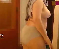 Sex thither Arab granny wearing a hijab in an Algerian knocking-shop