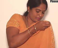 Mother enervating a yellow saree, video