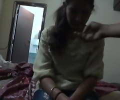 Indian – he fucks her doggy on bed and then she sits on bed