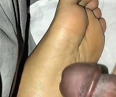 Cumming on sleeping Indian girls feet