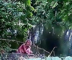 Desi aunty peeing open-air