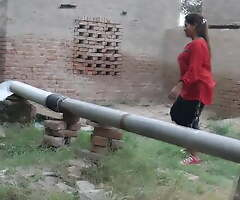 Desi Indian girl laving in pool, village girl taking bath
