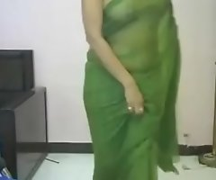 Desi girl alongside green sari. looking smokin' hot alongside indian song. Must watch.